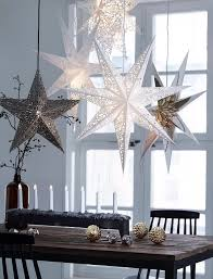 Winter Home Decorating Ideas by Beautiful Winter Tablescape With Hanging Stats U0026 White Candles