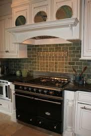 Motawi Tile Backsplash by Charley Harper Kitchen Backsplash Installation Lighting Up An