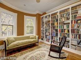 traditional library with hardwood floors u0026 crown molding in