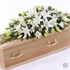 white casket spray funeral flowers
