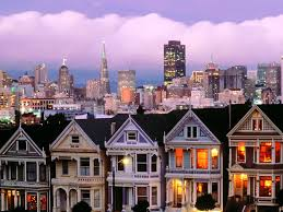 san francisco row homes and cityscape at dusk avenuewest