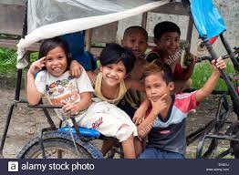 pedicab philippines children in pedicab village butuan philippines stock photo