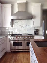 Fascinating White Kitchen With Stainless Steel Backsplash And - Custom stainless steel backsplash