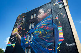 take a look at 15 new murals splashed on downtown lynn s brick marka27 s mural on exchange street in lynn