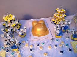 gold pregnant belly baby shower cake with minis and push pops