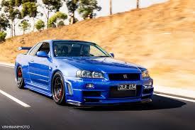 custom nissan skyline nissan skyline gt r r34 blue color black wheels red calipers