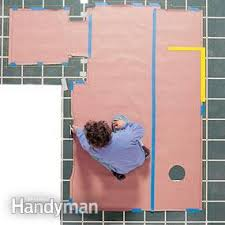 Installing Vinyl Sheet Flooring How To Install Vinyl Flooring In A Sheet The Family Handyman