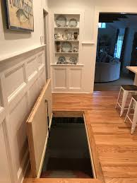 trap door down to the basement with a pressure lift for ease