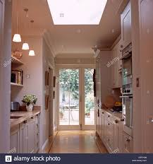 White Galley Kitchens Pendant Lights Above Worktop In White Galley Kitchen Extension