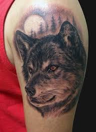 black and grey wolf portrait by tattoonow