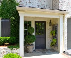 creating an enchanting front entry with architectural details white washed bricked exterior wall gray painted wooden front door procelain front entry floor white painted