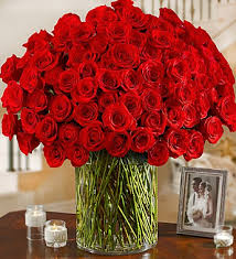 100 premium stem roses in a vase this is one of those