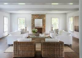 all white living room with white sofas and framed wall mirror