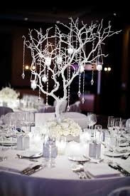branch centerpieces incorporate details to create a winter branch