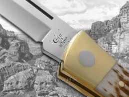 case xx jigged amber bone xx changer stainless utility pocket