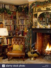 leather armchair in front of bookshelves and beside fireplace with