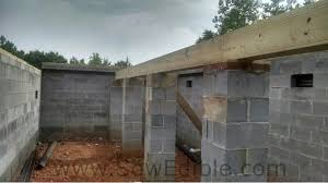 off grid house construction foundation subfloor and concrete porch