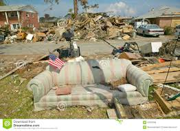 Pensacola Flag American Flag On Couch And Debris In Front Of House Heavily Hit By