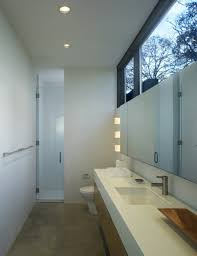 bathroom bathroom design with white floating sink plus storage