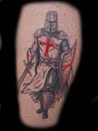 religious leg tattoos