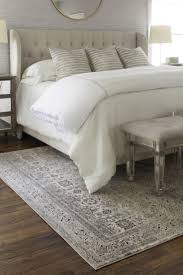 Bedrooms Small Side Table Side Chairs Beige Rug Artwork Blue by 5 Ways To Choose The Perfect Bedroom Rug Overstock Com