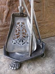 19th c polished steel and brass fireplace tool set and stand at