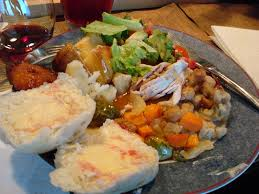 plate of thanksgiving food thanksgiving dinner plate bread stuffing turkey potatoes yam
