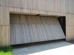 Martin Overhead Doors by Smartech U0027s Tilt Garage Door System Opens As A Single Panel
