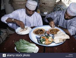 Select Comfort Stock Two Muslim Men Eat Using Only The Right Hand To Select Portions Of