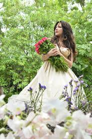 beautiful woman with bouquet of pink rose standing in a beautiful