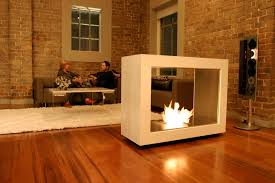 creative freestanding fireplace designs with brick wall decoration