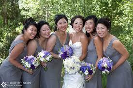 gray bridesmaid dress with blue bouquet weddingbee