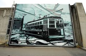 street smarting cover story style weekly richmond va local click to enlarge trask s murals dot the city he painted this trolley on a wall off the canal