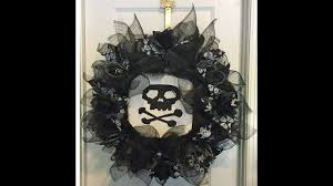 how to make a halloween wreath with mesh ribbon how to make a halloween wreath all black skull and crossbones poof