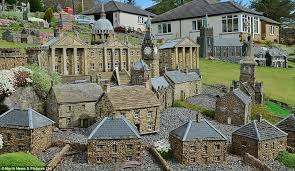 builder scales his work and creates three miniature villages