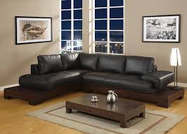 Living Room Decor Black Leather Sofa L Shaped Black Leather Sofa On Brown Wooden Base With White Table
