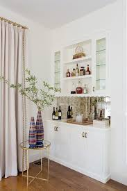 round accent table decorating ideas temasistemi net a round brass and glass accent table sits in front of a small white