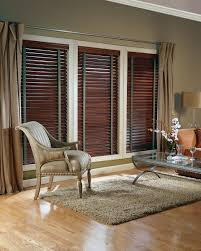 decorating window decor with brown wooden levolor blinds on tan