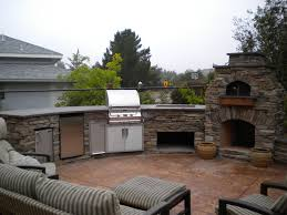 custom arched outdoor kitchen w fire magic appliances along