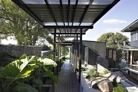 modern home landscape design in the front yard of modern house