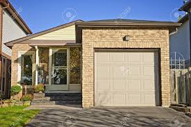garage door house suburban small bungalow house with single garage stock photo
