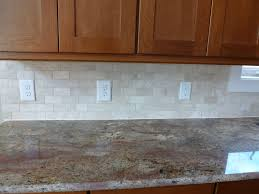 ceramic subway tile kitchen backsplash with square frame mosaic