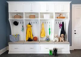 white mudroom lockers with blue walls traditional laundry room
