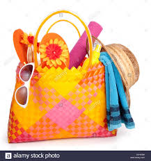 flip flop bag bag with towel sunglasses flip flops and hat isolated on
