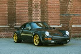 porsche 911 dark green gold and green porsche 911 sitting on brixton forged wheels carid