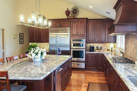 stained wood kitchen cabinets 2019 caring for your countertops cabinets flooring tracy tesmer