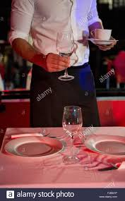 setting a table waiter setting a table stock photo royalty free image 97376770