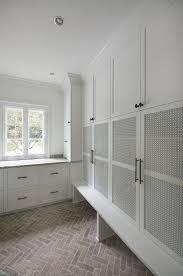 Mudroom Cabinets by Mudroom With Mesh Panel In Cabinet Doors Brick Herringbone Floor
