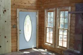 a beautiful log cabin log railing log window trim log door trim