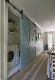 interior door dilemma laundry cupboard barn doors and clutter